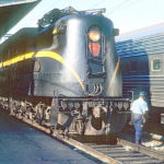 Carman at Union Station in Washington, D.C. passes in front of GG1 4936 - 1964